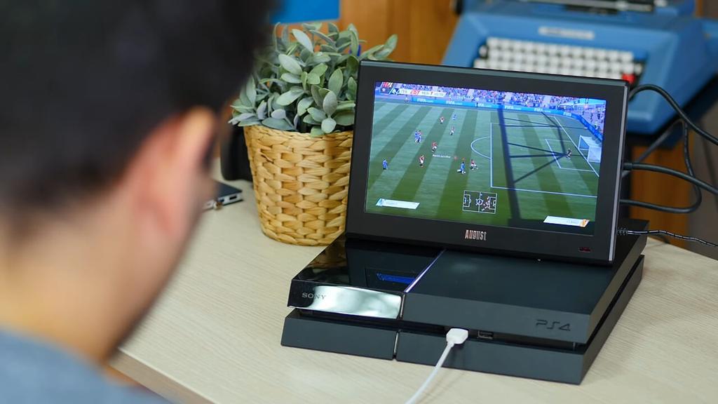 Jugando a PlayStation con el August DA100D